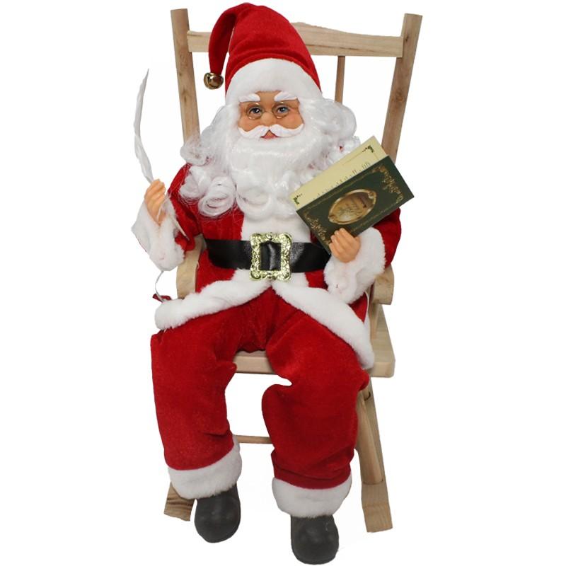 Babbo Natale Musicale.Babbo Natale Su Sedia Con Libro
