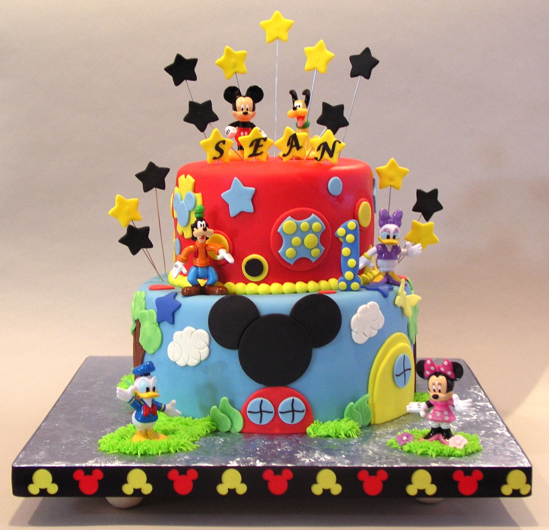 Torta topolino 10 ricette dalla casa di topolino disney for Piani casa ranch con 3 box auto